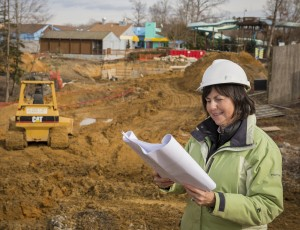 Suzy Cheely looks over plans at the Colossal Curl construction site. (Photo courtesy Water country USA)