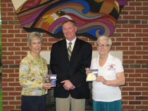 (L-R): Chairman of the Mamie Eisenhower Project Pat Barker, Library Manager Kevin Smith and Club President Mary Clark (Submitted)