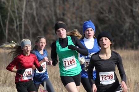 Rachel Brotherton passing through a pack of racers (Photo courtesy of the Greater Williamsburg Distance Running Club)