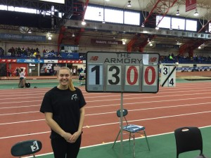 Kathryn Tomczak stands proudly next to a performance indicator with her cleared height at the New Balance National Indoors. (photo courtesy of Aim High Pole Vault Club)