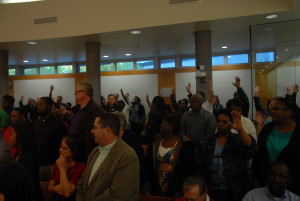 The meeting was packed with supporters of the church. At one point, everybody who was in support of the church was asked to stand and raise their hand. (Gregory Connolly/WYDaily)