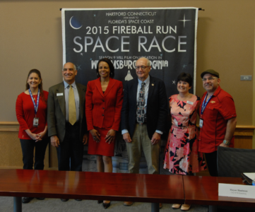 From left to right: Fireball Run Brand Integration Director Aidy Alonzo, Child Development Resources Executive Director Paul Scott, Virginia Tourism Corporation President and CEO Rita McClenny, Williamsburg Mayor Clyde Haulman, Greater Williamsburg Chamber & Tourism Alliance President and CEO Karen Riordan and Fireball Run Executive Producer J. Sanchez pose for a photo during a press conference of the show at the Williamsburg Municipal Building in April. (Gregory Connolly/WYDaily)