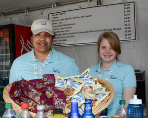 Two members of the Navy -- Joelie Hart and Lauren Lincoln -- work a concession stand during a practice round. (Photo courtesy of Ralph Kuhnley)