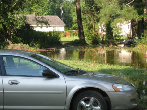 A neighborhood in Grove suffers from frequent pooling of water due to its lack of a drainage system. (Courtesy James City County)