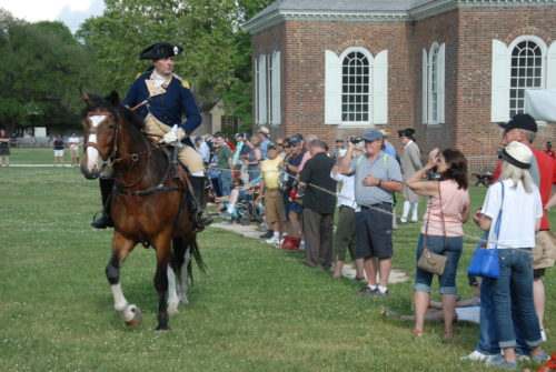 """A Colonial Williamsburg Historical Interpreter portraying George Washington talks to the crowd gathered for the """"On to Yorktown and Victory!"""" program on Wednesday. (Gregory Connolly/WYDaily)"""