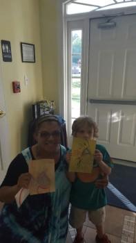 Roan Marley shows off some artwork with NATASHA House Executive Director Karen Brown.