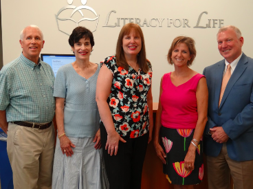 The new members Literacy for Life Board of Directors pose with the President of the Board for the coming fiscal year (from left to right): Bob Hershberger, Terry Murphy, Paula Mooradian, Kelly Ann Kelly, and Tom Spong.
