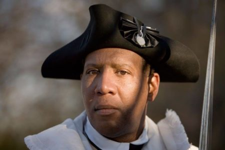 Jerome Bridges portrays Windsor Fry, a free Black soldier in the Rhode Island Light Infantry during the American Revolution.