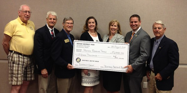 Officers of Rotary International District 7600 and local Rotary clubs present a check to the Williamsburg Regional Library. Left to right:  Andy Robinson, Rotary Club of The Historic Triangle; John Enright, President-elect, Rotary Club of James City County; James A. Probsdorfer, Foundation Chair, Rotary International District 7600; Genevieve S. Owens, Director, Williamsburg Regional Library; Sandra Towers, Youth Services Director, Williamsburg Regional Library; Jason Blanchard, President, Rotary Club of The Historic Triangle; Chuck Hobson, President, Rotary Club of Williamsburg.