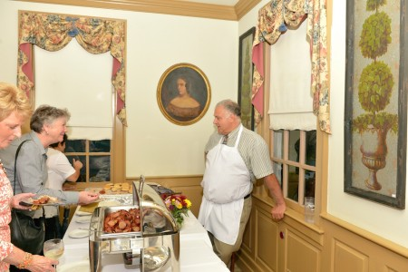 Owner Maxine William's husband John, a lawyer, became passionately involved with CASA ten years ago. Chickahominy House raised over $60,000 for CASA through yearly fundraisers over the past decade. Here he's serving up Chickahominy House favorites. (Courtesy Andrew Jackson, Savand Action Photography)