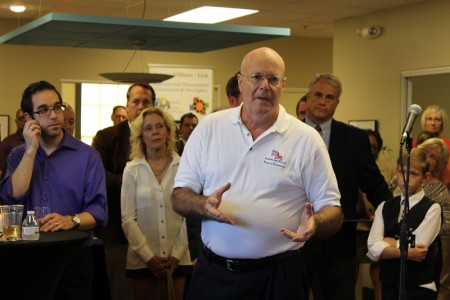"""John Sullivan, co-owner of American Eagle Flag & Flagpole, LLC, talks about how Launchpad helped him have a """"soft landing"""" when he relocated to Williamsburg during the grand opening of the business incubator's location in New Town Sept. 18, 2015. (Kirsten Petersen/ WYDaily)"""