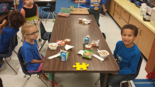 Coventry Elementary School students Madelyn Shields and Juston Shannon enjoy eating breakfast in their first period classroom. (Courtesy YCSD)