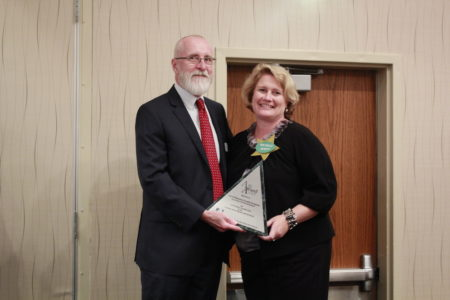 Fred Brayersdorfer, President of the Cultural Alliance of Greater Hampton Roads, presents the Alli Award to Michele Mixner DeWitt, Director of Economic Development for the City of Williamsburg. (Courtesy City of Williamsburg)