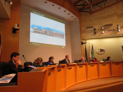 WJCC School Board members review a sketch of the front elevation for the fourth middle school during the Dec. 15, 2015 regular meeting. (Kirsten Petersen/ WYDaily)