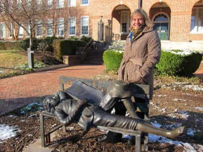 Julie Hummel, the newest City of Williamsburg representative on the WJCC School Board, stands outside Matthew Whaley Elementary School Jan. 18 with a statue of the school's namesake, which the PTA purchased when she was president after the school building's 75th anniversary in 2006. (Kirsten Petersen/ WYDaily)