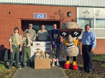 From left: John Spratt, Scoutmaster; Neil Smith, Assistant Scoutmaster; Erik Smith, Boy Scout; Xavier Spratt, Boy Scout; John Spratt, Jr., Boy Scout; Todd Smith, Whitley's President; Roger Sams, Whitley's Vice President of Sales; and Whit, the Whitley's Peanut Factory mascot.