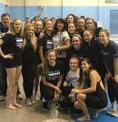 York's girls swim team poses together after winning the Group 3A East meet. (Photo courtesy of York Athletics)