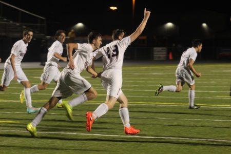 Grafton soccer players celebrate a goal. (file photo)