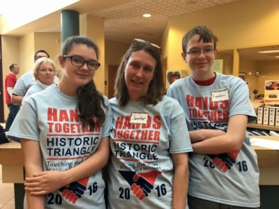Jennifer Howlett and her children Lyndon and Katy were all enthusiastic volunteers at Hands Together Historic Triangle. (Courtesy Natalie Miller Moore)
