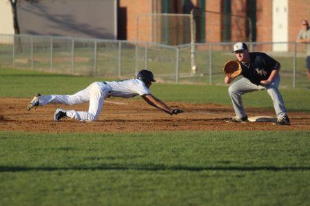 Garrick Colorado dives back to first base. (file photo)