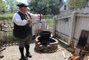 Interpreter John King demonstrates the dipping method of candle making. (Elizabeth Hornsby/WYDaily)