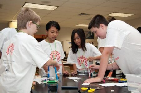 A group of students tinker during the Invention Project summer camp. (Photo courtesy of Invention Project)
