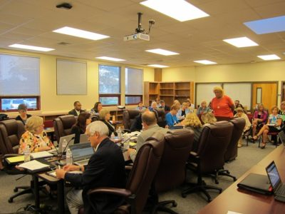 """Edith """"Cookie"""" Heard asks WJCC School Board members to discuss changing the name of Rawls Byrd Elementary School May 10, 2016. (Photo by Kirsten Petersen)"""