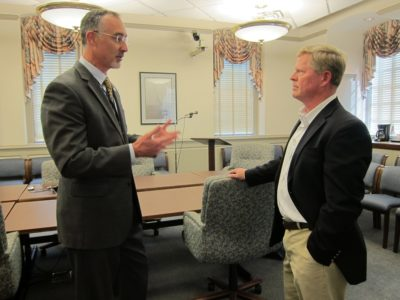 York County School Division Superintendent Victor Shandor (left) speaks with interim Dist. 4 representative Todd Mathes after he was appointed May 19, 2016. (Photo by Kirsten Petersen)