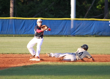 Grafton second baseman C.J. Roth takes a throw that just beats a Monticello base runner. (Photo courtesy Jerry Sprouse/PhotoReflect)