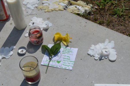 A memorial in front of 1094 Stewart Drive was created for Kameron Stanley, 18, who was shot to death Friday evening. (Kim Lenz/WYDaily)