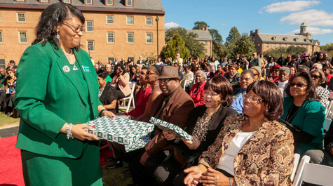 Chief Diversity Officer Chon Glover (left) presents replicas of the Hardy Hall plaque to members of Hardy's family. (Photo by Skip Rowland '83)