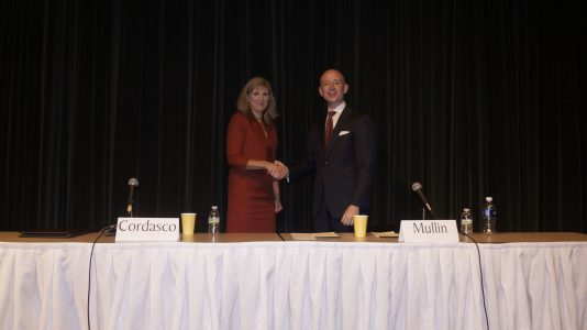 Heather Cordasco (R) and Mike Mullin (D) shake hands after the League of Women Voters of the Williamsburg area forum.