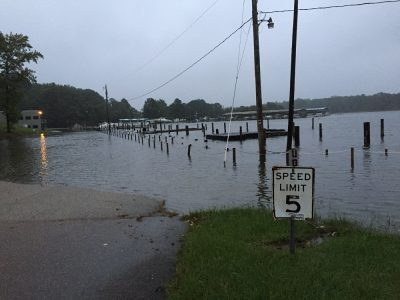 Coastal flooding at the Jamestown Marina in October 2015 caused water to spill over the dock and into the parking lot. (Courtesy of Jan Walker/WYDaily file photo)