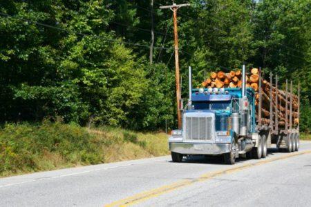 Logging truck,vehicle on highway near Skohegan Maine