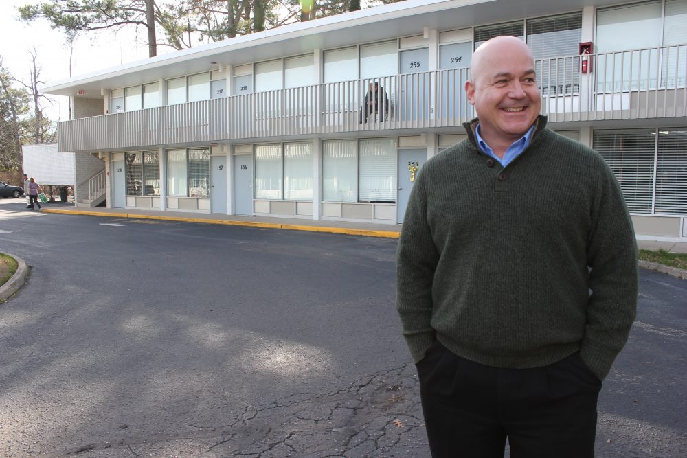 Quarterpath Inn owner Doug Pons stands in front of the motel in December. (Sarah Fearing/WYDaily)