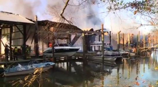 In a Facebook Live video stream, Henrico Fire Department is seen battling the blaze at the Richmond Yacht Basin on Friday morning. (Courtesy Facebook Live/WTVR)