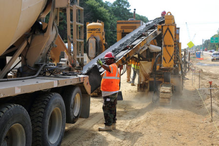 Crews pour the concrete footing for the median barrier, a quarter of a mile west of the Route 105 Fort Eustis interchange on I-64. (Courtesy VDOT.)
