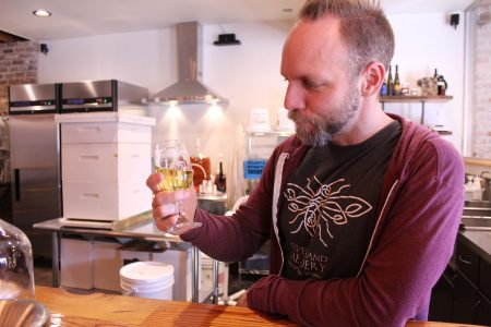 Glenn Lavender taste tests a mead at the Silver Hand Meadery Jan. 19. (Sarah Fearing/WYDaily)