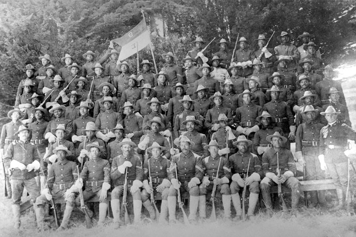 """Officers and men also called """"Buffalo Soldiers"""" of the U.S. Army's all-black 9th Calvary Regiment take a group photo prior to deploying from San Francisco to participate in combat operations in the Philippine-American War. (Courtesy U.S. Army Center of Military History)"""