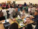 A York County Fire & Life Safety member eats lunch with children at Magruder Elementary School. (Courtesy York County School Division)
