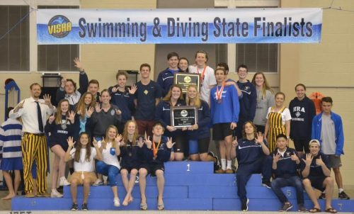 The Hampton Roads Academy boys and girls swim teams celebrate their 6th consecutive Division II state title at the Virginia Independent Schools Athletic Association Swimming and Diving Championship