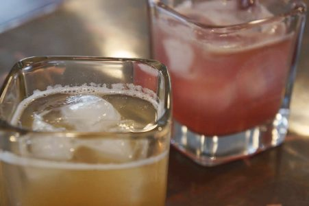 On the rocks or on tap, local brewers and distillers are getting creative with winter ingredients, like these pear- and grapefruit-infused cocktails at Copper Fox Distillery. (Steve Roberts/WYDaily)