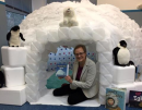 Interim Director Janet Crowther invites children and adults to curl up with a good book inside the library's reading igloo. (Courtesy Williamsburg Regional Library)