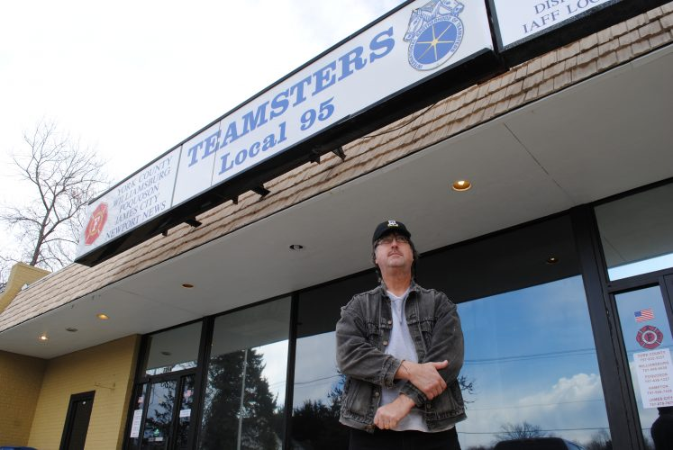 Retired firefighter Joe Woolard stands outside the firefighter's union headquarters. (Sarah Fearing/WYDaily)