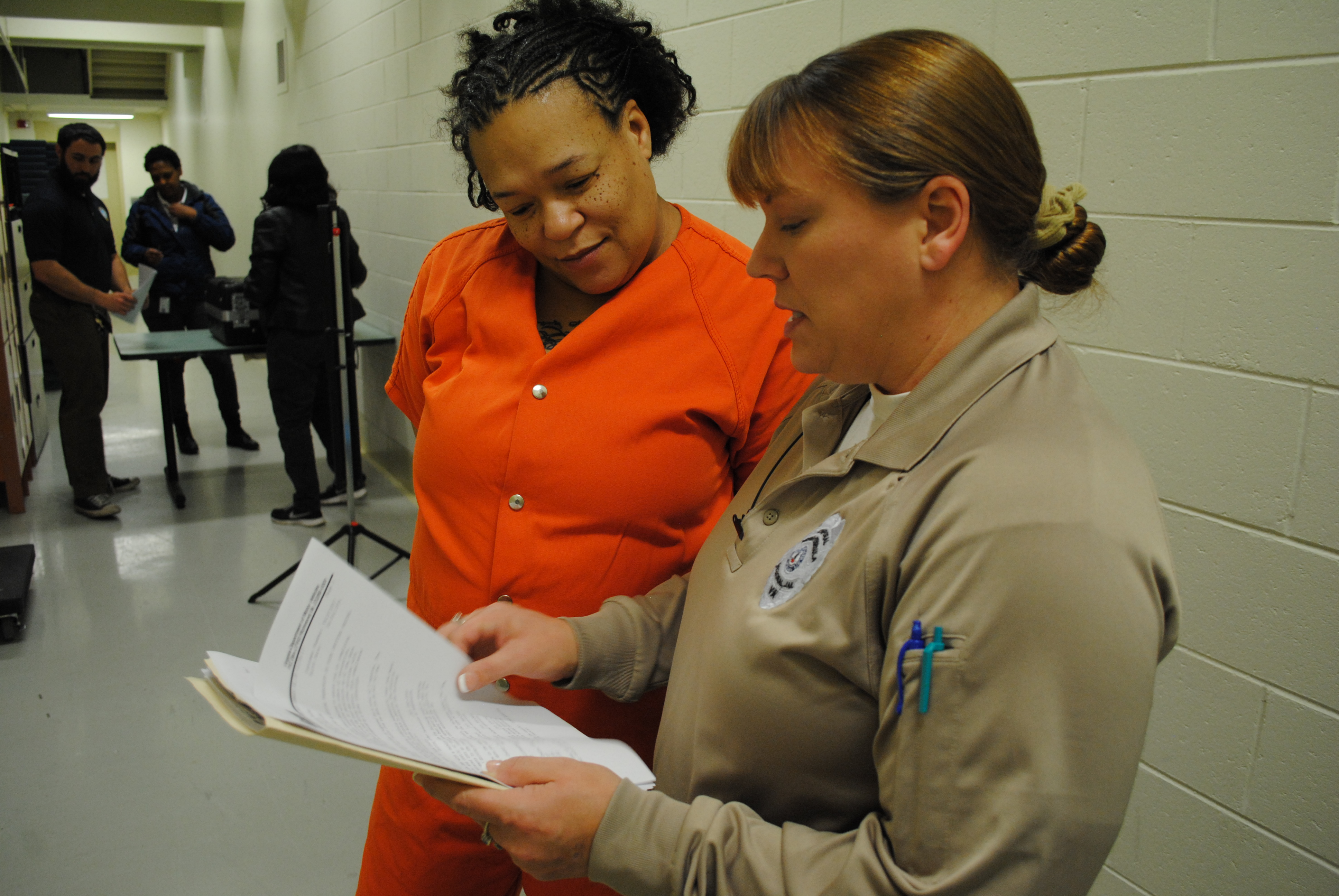 Crystal Stuckey goes over her compliance sheet with Cpl. Christina McCain. The sheet shows the steps Stuckey needs to take to reinstate her license. (Sarah Fearing/WYDaily)
