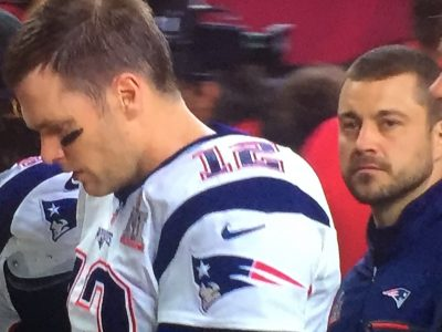 James Hardy stands behind New England Patriots Quarterback Tom Brady Feb. 5, as we witnessed the largest Super Bowl comeback in history. (Courtesy James Hardy)