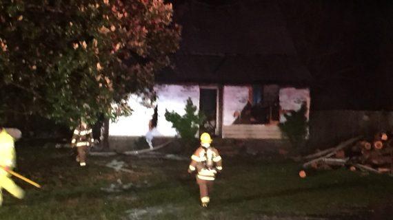 Firefighters battle early morning blaze on Penniman Road; two dogs rescued