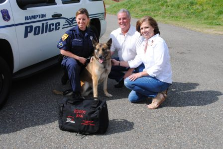 Hampton officer Angie Dipentima and K9 Ranger pose with Patricia Settimo and her husband, Sam Settimo Tuesday morning. (Sarah Fearing/WYDaily)