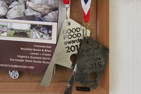 Two medals hang in Sam Edwards III's office- one of which was charred in the smokehouse blaze. (Andrew Harris/WYDaily)