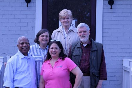 GWOM Board members pose on Grace Haven's front porch. From left to right: Treasurer Jasper Gay, Secretary Helen Hansen, Chair Shannon Woloszynowski, Community Kitchen Director Stephanie Slocum, and Vice Chair Carl Gerhold. (Andrew Harris/WYDaily)